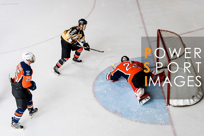 Naoki Kaneko of Empire Skate (L) battle in the goal mouth with Singapore Hawkers Goalie George Chow (R) during the Mega Ice Hockey 5s match between Singapore Hawkers and Empire Skate on May 04, 2018 in Hong Kong, Hong Kong. Photo by Marcio Rodrigo Machado / Power Sport Images