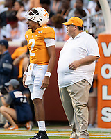KNOXVILLE, TN - OCTOBER 5: Former Georgia offensive coordinator and now the Tennessee offensive coordinator Jim Chaney chats with quarterback Jarrett Guarantano #2 of the Tennessee Volunteers before the game during a game between University of Georgia Bulldogs and University of Tennessee Volunteers at Neyland Stadium on October 5, 2019 in Knoxville, Tennessee.