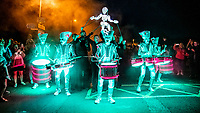 BNPS.co.uk (01202 558833)<br /> Pic: MaxWillcock/BNPS<br /> <br /> Lighting up the night.<br /> <br /> Pictured: The Spark! drummers and the Dundu puppeteers perform to the crowds during the Sense of Unity parade through Weymouth in Dorset.<br /> <br /> Spark! is a street theatre show performed by five characters that combines high-impact drumming, dynamic choreography and beautiful lighting design.