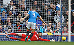 Wes Foderingham tips the ball away