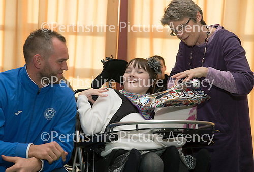 St Johnstone players visit Fairview School in Perth.....19.12.13<br /> Alan Mannus is pictured playing pass the parcel with Erin Neill<br /> Picture by Graeme Hart.<br /> Copyright Perthshire Picture Agency<br /> Tel: 01738 623350  Mobile: 07990 594431