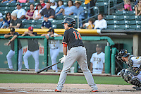 Max Stassi (12) of the Fresno Grizzlies at bat against the Salt Lake Bees in Pacific Coast League action at Smith's Ballpark on June 13, 2015 in Salt Lake City, Utah.  (Stephen Smith/Four Seam Images)