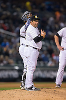 Charlotte Knights manager Julio Vinas (45) makes a pitching change during the game against the Durham Bulls at BB&T BallPark on April 14, 2016 in Charlotte, North Carolina.  The Bulls defeated the Knights 2-0.  (Brian Westerholt/Four Seam Images)