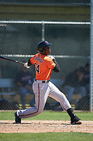 Baltimore Orioles Randolph Gassaway (64) follows through on a swing during a minor league Spring Training game against the Minnesota Twins on March 17, 2017 at the Buck O'Neil Baseball Complex in Sarasota, Florida.  (Mike Janes/Four Seam Images)