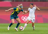 KASHIMA, JAPAN - JULY 27: Ellie Carpenter #12 of Australia defends Christen Press #11 of the USWNT during a game between Australia and USWNT at Ibaraki Kashima Stadium on July 27, 2021 in Kashima, Japan.