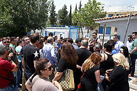 "Pictured: Local people show their solidarity by gathering outside the 6th primary School in Acharnes, Athens, Greece. Saturday 10 June 2017<br /> Re: An 11 year old boy has been shot dead by a ""stray bullet"" during a school celebration in Acharnes (Menidi) area, in the outskirts of Athens, Greece.<br /> Marios Dimitrios Souloukos ""complained to his mum"" who works as a teacher at the 6th Primary School of Acharnes that he was feeling unwell, he then collapsed with blood pouring out from the top of his head.<br /> His mum tried to revive him assisted by other teachers while his schoolmates who were reportedly upset, were hurriedly removed by their parents.<br /> According to locals an ambulance arrived 25 minutes late.<br /> Hundreds of police officers have been deployed in the area and have raided many properties.<br /> Shells matching the fatal bullet which hit the boy on the top of his head were found in a house yard nearby.<br /> Local people reported hearing shots being fired at a nearby Romany Gypsy camp before the fatal incident.<br /> The area has been plagued with criminality during the last few years."