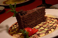 illustration photo<br /> A piece of chocolate cakewith strawberries and sauce  sit in a plate in a Montreal Italian restaurant<br /> Photo by Pierre Roussel / Liaison<br /> NOTE : D-1 Tiff opened as NTSC, saved as Adobe RBG Jpeg