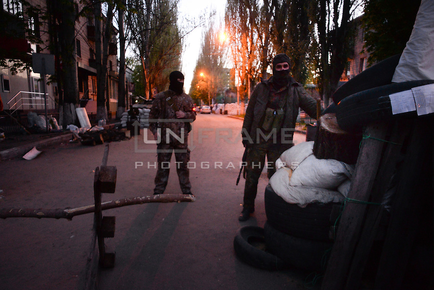 Pro-russian activists, member of Civil army of Donbas protecting the heavily reinforced office of Security service of Ukraine in Slavyansk city.
