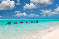 Group of horse riders in water. Providenciales. Turks and Caicos.