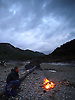Enjoying a camp fire in the Ystwyth valley about 12 miles inland from Aberystwyth. The river is low and it is a beautiful place to spend the evening.<br /> <br /> Stock Photo by Paddy Bergin
