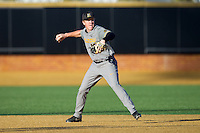 Missouri Tigers shortstop Josh Lester (17) makes a throw to first base against the Wake Forest Demon Deacons at Wake Forest Baseball Park on February 22, 2014 in Winston-Salem, North Carolina.  The Demon Deacons defeated the Tigers 1-0.  (Brian Westerholt/Four Seam Images)