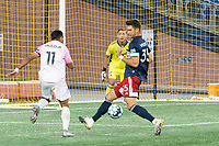 FOXBOROUGH, MA - SEPTEMBER 04: Collin Verfurth defending as Paulo Junior attacks the goal during a game between Forward Madison FC and New England Revolution II at Gillette Stadium on September 04, 2020 in Foxborough, Massachusetts.