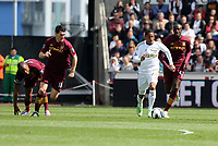 Pictured: Jonathan de Guzman of Swansea (with ball) is chased by L-R Vincent Kompany, Gareth Barry and Yaya Toure of Manchester City. Saturday 04 May 2013<br />
