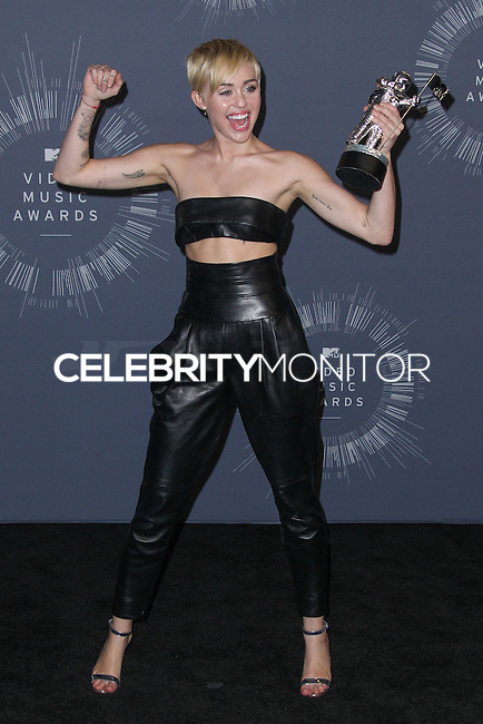 INGLEWOOD, CA, USA - AUGUST 24: Singer Miley Cyrus, winner of Video of the Year award for 'Wrecking Ball', poses in the press room at the 2014 MTV Video Music Awards held at The Forum on August 24, 2014 in the Inglewood, California, United States. (Photo by Xavier Collin/Celebrity Monitor)