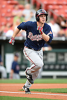 Gwinnett Braves outfielder Todd Cunningham (20) runs to first during a game against the Buffalo Bisons on May 13, 2014 at Coca-Cola Field in Buffalo, New  York.  Gwinnett defeated Buffalo 3-2.  (Mike Janes/Four Seam Images)