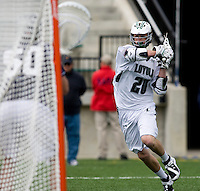 Collin Finnerty (20) of Loyola takes a shot on goal at the Ridley Athletic Complex in Baltimore, MD.  Loyola defeated Georgetown, 11-6.