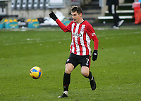 Sergi Canos of Brentford in action during Brentford vs Leicester City, Emirates FA Cup Football at the Brentford Community Stadium on 24th January 2021