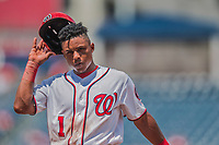 16 August 2017: Washington Nationals infielder Wilmer Difo removes his helmet and returns to the dugout during a game against the Los Angeles Angels at Nationals Park in Washington, DC. The Angels defeated the Nationals 3-2 to split their 2-game series. Mandatory Credit: Ed Wolfstein Photo *** RAW (NEF) Image File Available ***