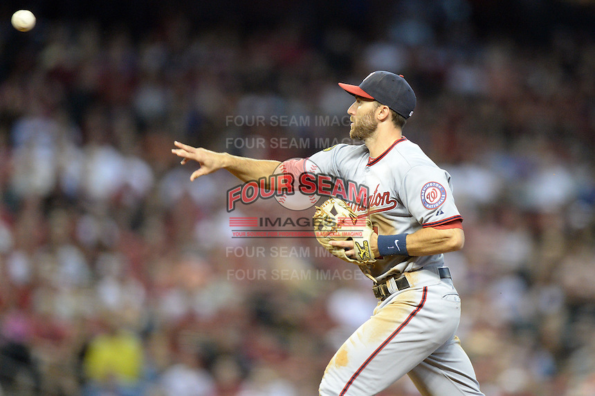 Washington Nationals second baseman Steve Lombardozzi (1) throws to second during a run down during a game against the Arizona Diamondbacks at Chase Field on September 29, 2013 in Phoenix, Arizona.  Arizona defeated Washington 3-2.  (Mike Janes/Four Seam Images)