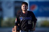 Missoula Osprey starting pitcher Dustin Lacaze (40) walks off the field between innings of a Pioneer League game against the Great Falls Voyagers at Centene Stadium at Legion Park on August 19, 2019 in Great Falls, Montana. Missoula defeated Great Falls 4-1 in the first game of a doubleheader. Games were moved from Missoula after Ogren Park at Allegiance Field, the Osprey's home field, was ruled unplayable. (Zachary Lucy/Four Seam Images)