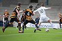 Raith Rovers' Joe Cardle's (hidden left) cross / shot goes under the legs of Calum Elliot for their first goal.