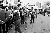 UNDATED  FILE PHOTO - Workers make a human chain on worker's day - May first in the seventies.<br /> <br /> Photo : Alain Renaud<br />  - Agence Quebec Presse