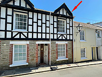 BNPS.co.uk (01202) 558833. <br /> Pic: LillicrapChilcott/BNPS<br /> <br /> A pretty waterfront townhouse with incredible panoramic views in a holiday home hotspot is on the market for £725,000.<br /> <br /> This attractive Cornish bolthole is in a sought after spot in Fowey, with 'jaw-dropping' views from almost every window and direct access to the river below the back of the house.<br /> <br /> Estate agents Lillicrap Chilcott say the four-storey, two-bedroom home is the perfect lock up and leave in the incredibly desirable tourist location.  <br /> <br /> It has not been on the market for 26 years and was completely refurbished by the owner about nine years ago. He has used it as a second home and earned a healthy income as a holiday let as well.