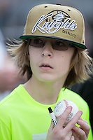 A young Charlotte Knights fan tried to get his baseball autographed prior to the exhibition game against the Chicago White Sox at BB&T Ballpark on April 3, 2015 in Charlotte, North Carolina.  The Knights defeated the White Sox 10-2.  (Brian Westerholt/Four Seam Images)