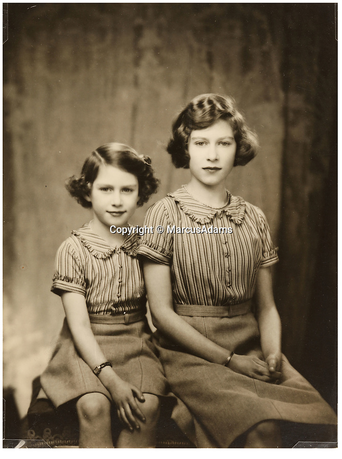 BNPS.co.uk (01202 558833)<br /> Pic: MarcusAdams/ChiswickAuctions/BNPS<br /> <br /> Princess Margaret and Princess Elizabeth during WW2.<br /> <br /> Charming childhood photos of Princess Elizabeth and Princess Margaret have come to light, including a previously unseen image of the future Queen in a kilt.<br /> <br /> The portraits, taken by acclaimed British society photographer Marcus Adams, capture the future Queen from being a baby to her adolescence.<br /> <br /> The Queen Mother would often take her daughters to his central London studio where he would set up toys and props to keep them entertained