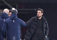 12th January 2021; Vitality Stadium, Bournemouth, Dorset, England; English Football League Championship Football, Bournemouth Athletic versus Millwall; Jason Tindall Manager of Bournemouth bumps hands with the Millwall management team after the final whistle the match ending 1-1