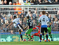 Jamaal Lascelles of Newcastle United (left) scores their first goal during the Barclays Premier League match between Newcastle United and Swansea City played at St. James' Park, Newcastle upon Tyne, on the 16th April 2016