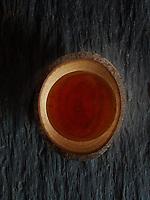 A rare honey in a wooden bow. The magic of colors.<br /> Un miel rare dans un bol en bois. Magie des couleurs.