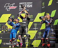 29th August 2021; Silverstone Circuit, Silverstone, Northamptonshire, England; MotoGP British Grand Prix, Race Day; The riders take a drink of the Prosecco