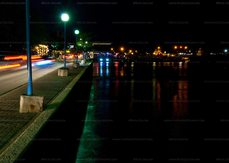 Kralendijk, Bonaire, Netherland Antilles -- Traffic moves steadily along the waterfront road most nights in the busy entertainment district at the waterfront in Kralendijk.