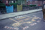 """Royal May Day Knutsford, Cheshire, England. 1973. Sand Painting out side the home of May Queens grandfather. It reads """"God Bless Our Royal May Queen."""""""