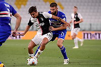 Paulo Dybala of Juventus and Lorenzo Tonelli of UC Sampdoria compete for the ball during the Serie A football match between Juventus FC and UC Sampdoria at Juventus stadium in Turin (Italy), July 26th, 2020. Play resumes behind closed doors following the outbreak of the coronavirus disease. <br /> Photo Federico Tardito / Insidefoto