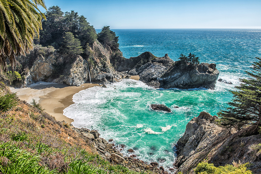 A view of McWay Falls and the surrounding cove from a hiking trail in Julia Pfeiffer Burns State Park, Big Sur, California