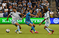 KANSAS CITY, KS - MAY 29: Graham Zusi #8 of Sporting KC, Memo Rodriguez #8 of Houston Dynamo FC and Gianluca Busio #10 of Sporting KC battle for the ball in midfield during a game between Houston Dynamo and Sporting Kansas City at Children's Mercy Park on May 29, 2021 in Kansas City, Kansas.