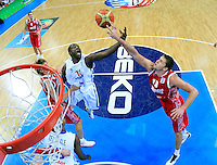 French national basketball team player Pietrus Florent fights for the ball with Russian Khryapa Victor (10) during semifinal basketball game between France and Russia in Kaunas, Lithuania, Eurobasket 2011, Friday, September 16, 2011. (photo: Pedja Milosavljevic)