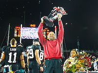 STANFORD, CA - November 30, 2012:  Stanford head coach David Shaw accepting the PAC 12 Championship trophy after the Stanford Cardinal vs the UCLA Bruins game at Stanford Stadium in Stanford, CA. Final score Stanford Cardinal 27, UCLA Bruins 24.