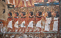 Ancient Egyptian wall paintings of the Tomb of Iti and Neferu, Mourning Scene, Thebes, First Intermediate Period (2118 – 1980BC). Egyptian Museum, Turin. Schiapelli excavations cat 1435.<br /> <br /> The upper two registers show a procession of men and women converging on a unidentifiable element, no destroyed.<br /> These tempera paintings were on a crude mud and straw plaster and were of typical Old Kingdom tombs showing ritual offering scenes. The tomb was partly cut into rock with mud brick walls and vaults. The facade of the tomb had 16 columns looking over a courtyard sloping towards the valley.