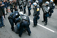 Montreal (Qc) CANADA -Oct 22 2009 - POlice arrest during a  Protest against George W Bush speech at The Queen ElizAbeth Hotel