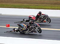 Mar 17, 2019; Gainesville, FL, USA; NNHRA top fuel Harley Davidson nitro motorcycle rider Rickey House (near) does a wheelstand alongside Doug Vancil during the Gatornationals at Gainesville Raceway. Mandatory Credit: Mark J. Rebilas-USA TODAY Sports