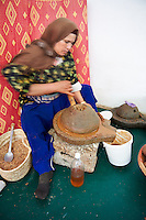 Women milling roasted Argan nuts at the Cooperative Marjana, Ounara, Essouira, Morocco