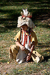 A young Native American Indian boy with a fur hat