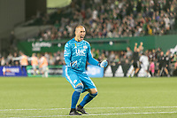 Portland, Oregon - Wednesday September 25, 2019: Brad Knighton #18 reacts to the New England Revolution scoring penalty kick to tie the game at 2-2 during a regular season game between Portland Timbers and New England Revolution at Providence Park on September 25, 2019 in Portland, Oregon.