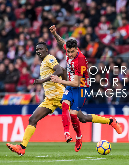 Jose Maria Gimenez de Vargas (R) of Atletico de Madrid competes for the ball with Michael Olunga Ogada of Girona FC during the La Liga 2017-18 match between Atletico de Madrid and Girona FC at Wanda Metropolitano on 20 January 2018 in Madrid, Spain. Photo by Diego Gonzalez / Power Sport Images