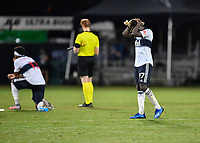 LAKE BUENA VISTA, FL - JULY 26: Leonard Owusu of Vancouver Whitecaps FC is distraught after missing his shootout attempt during a game between Vancouver Whitecaps and Sporting Kansas City at ESPN Wide World of Sports on July 26, 2020 in Lake Buena Vista, Florida.