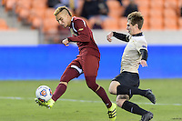 Houston, TX - Friday December 9, 2016: Andre Shinyashiki (9) of the Denver Pioneers takes a shot at the goal while Kevin Politz (4) attempts to block the kick at the NCAA Men's Soccer Semifinals at BBVA Compass Stadium in Houston Texas.