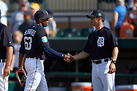 Detroit Tigers center fielder Wynton Bernard (63) shakes hands with manager Brad Ausmus (right) after winning an exhibition game against the Florida Southern Moccasins on February 29, 2016 at Joker Marchant Stadium in Lakeland, Florida.  Detroit defeated Florida Southern 7-2.  (Mike Janes/Four Seam Images)